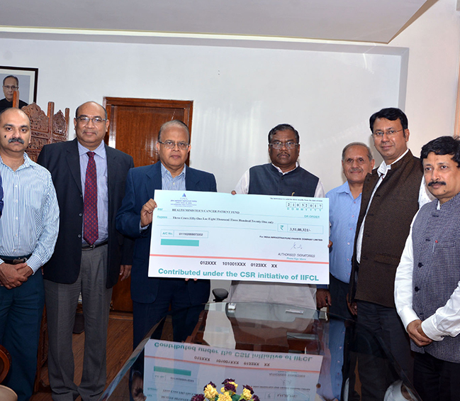 CMD Shri. S B Nayar presents a cheque of Rs. 3,51,08,321/- to the Hon'ble Minister of State (MoHFW) Shri. Faggan Singh Kulaste towards IIFCL contribution under its CSR to the Health Minister's Cancer Patient Fund (HMCPF)""